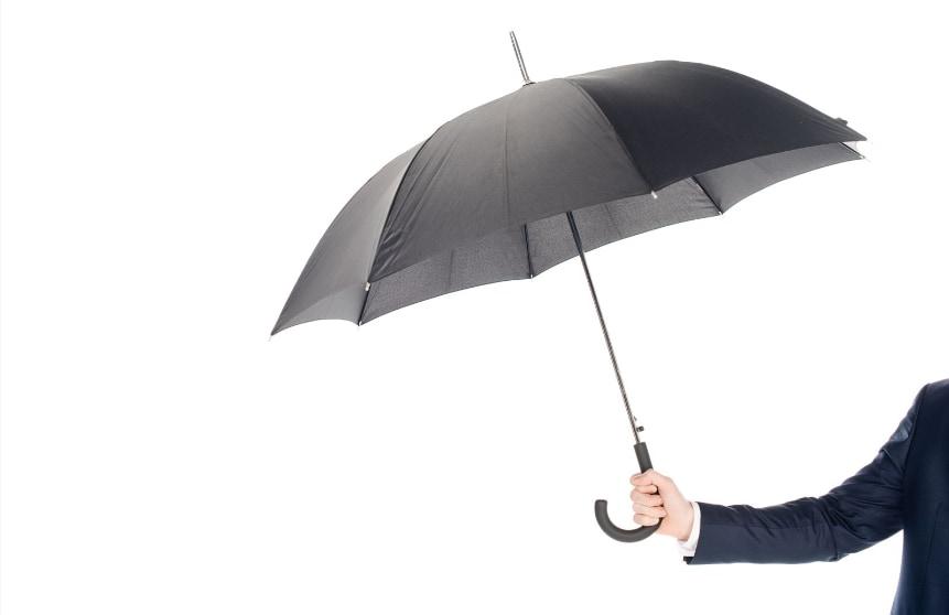 Umbrella Policy man holding umbrella